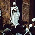 white robed parishioner